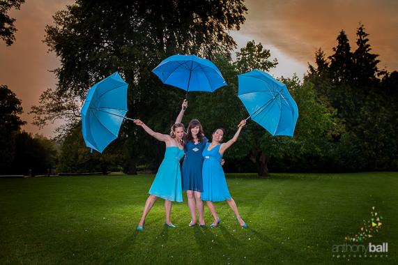 Blue umbrellas and Bridesmaids