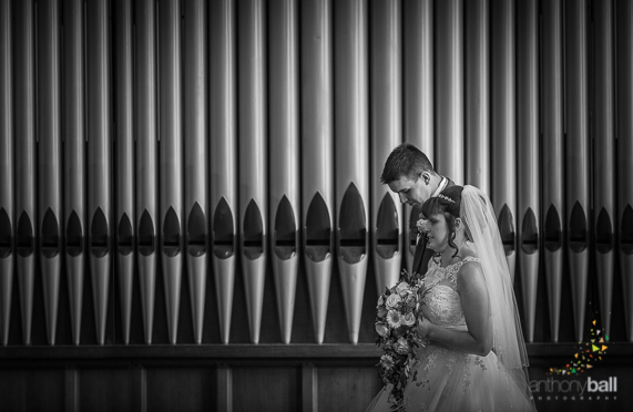Bride and Groom by Church Organ Pipes