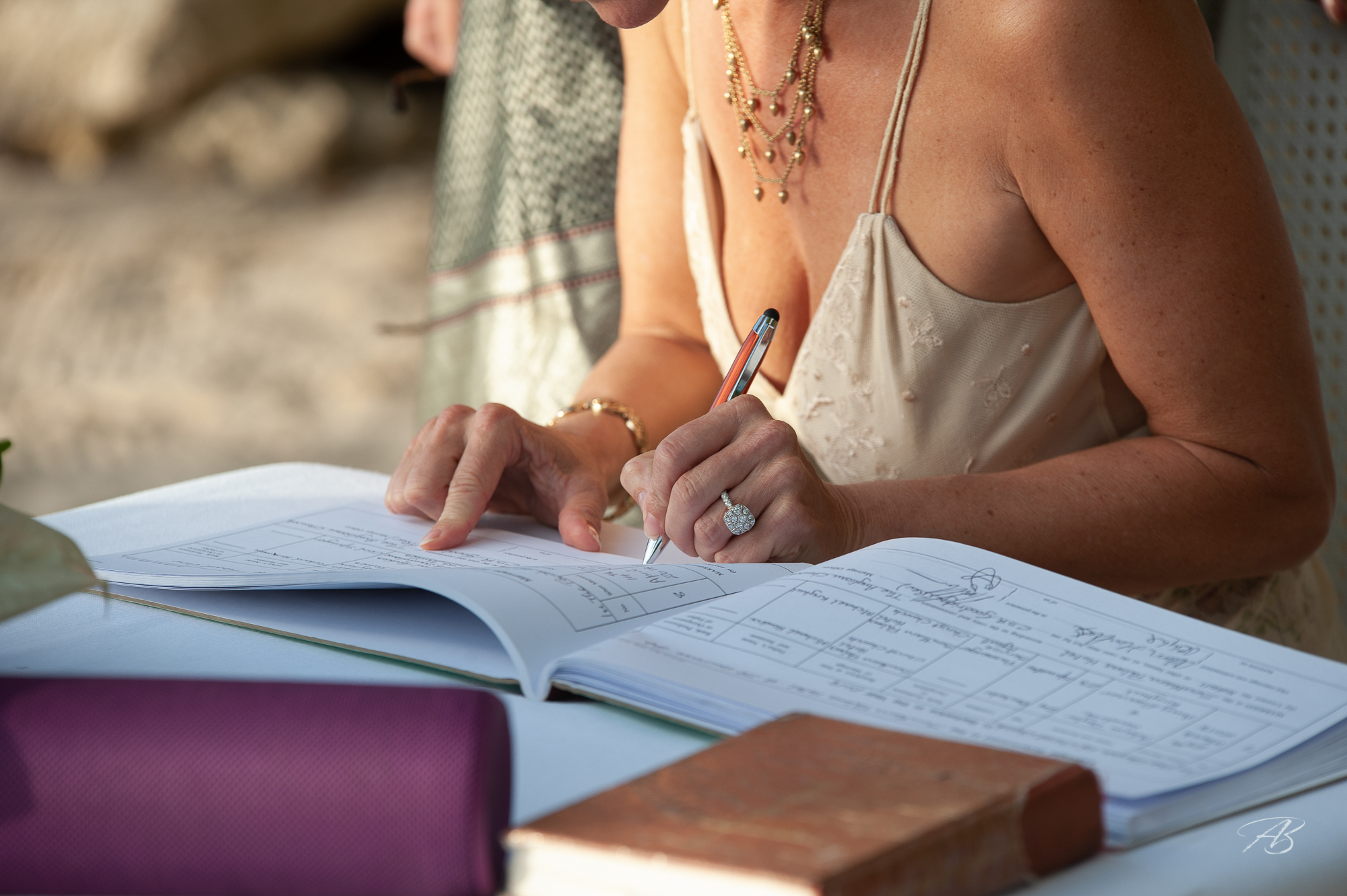 Signing the register at an intimate beach wedding